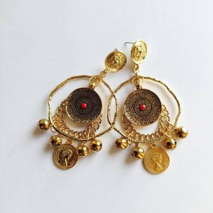 Brass hoop earrings with red stone ..