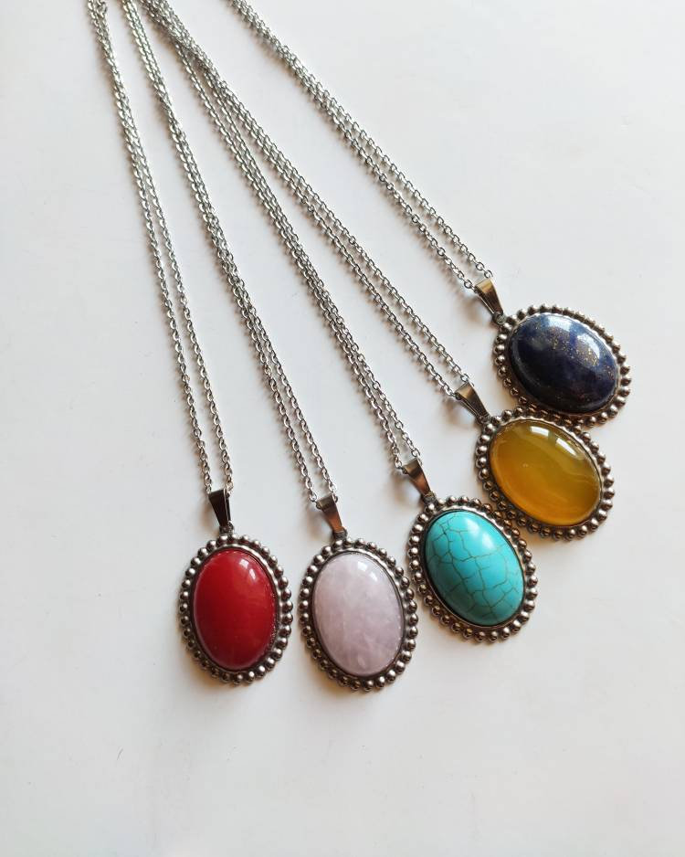 Stainless steel necklace (all steel)with 0 oval stone 25 to 18 mm