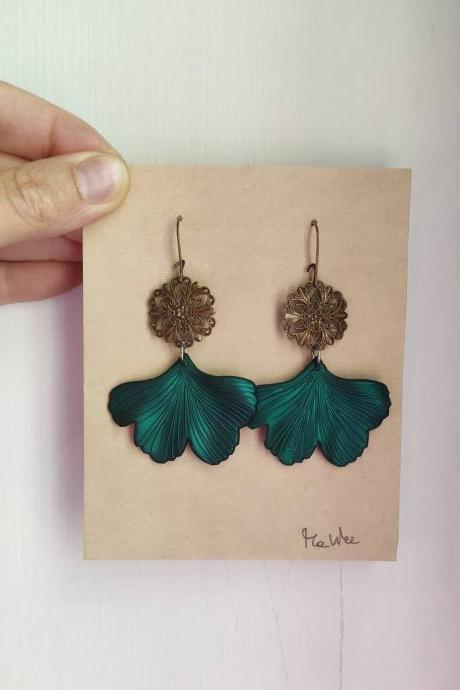 Gold brass dangling earrings in ginkobiloba in bright green resin with zigzagged leaf