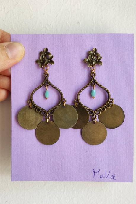 Bronze brass pendant earrings, with a small, crystal blue flower-shaped lobe closure
